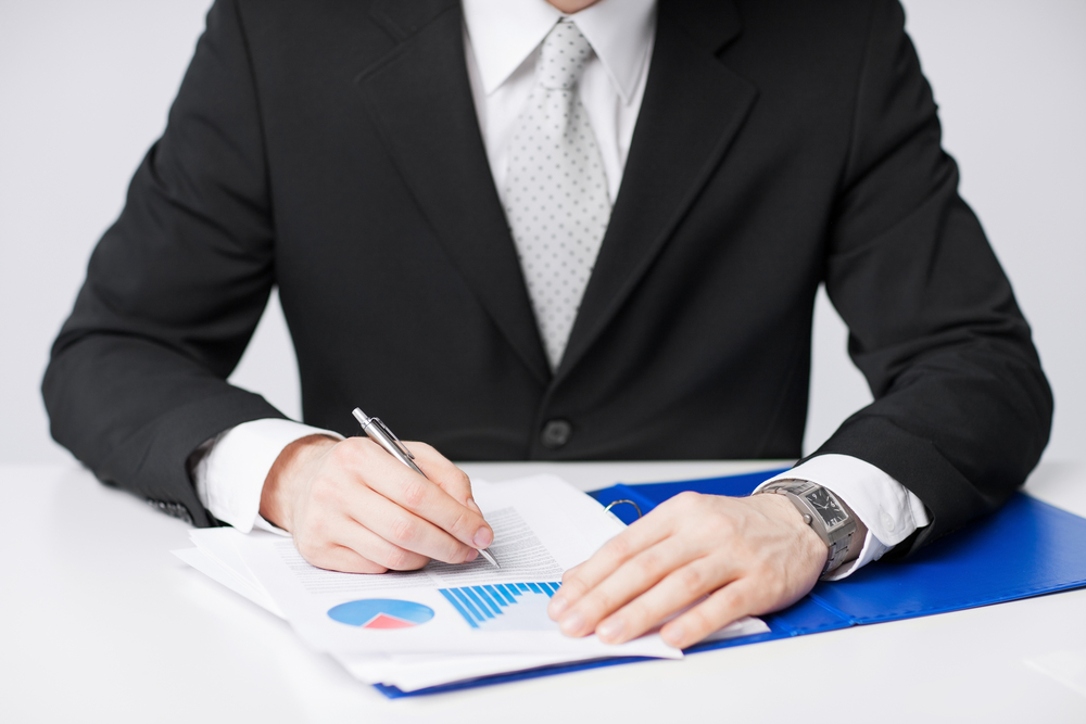 lawyer-signing-document-cropped-view-sitting-white-desk-legal-32580995.jpg