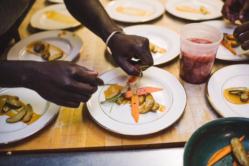 Chef Eric Adjepong plates the South African inspired Chicken Roulade with Piri-piri mayo sauce for dinner guests | Photo: Chi-Chi Agbim, Two Twenty