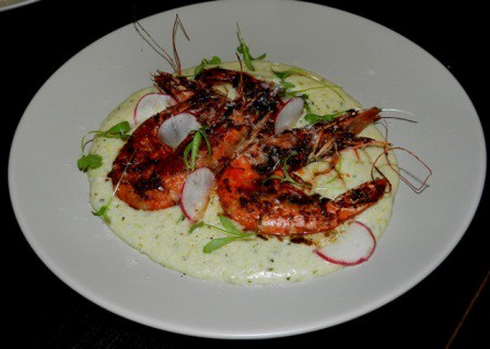 Jerk head on prawns over jalapeno coconut grits| Photo : Dine Diaspora