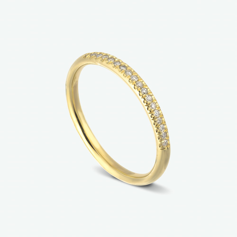 Classic and elegant, this diamond half eternity ring in composed of 14k yellow gold.  D: 0.09 ct.