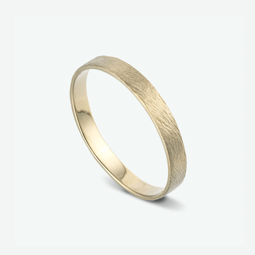 This elegant ring is a beautiful example of a unisex wedding ring, composed of 14k white gold.