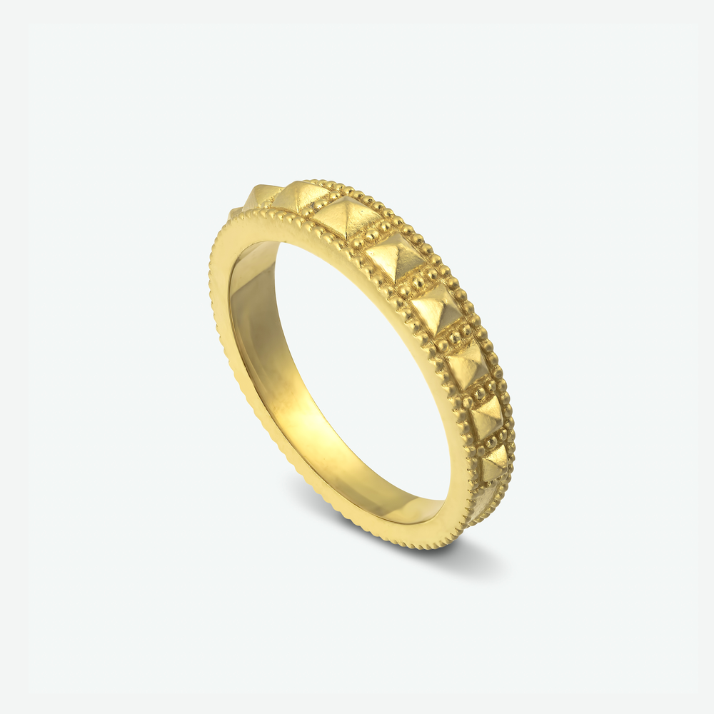 A 14k yellow gold studded wedding ring, has an antique vibe to it.