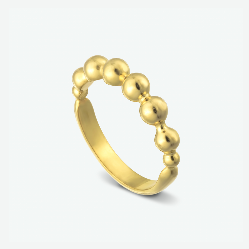 A lovely wedding ring Inspired by antique jewelry and composed of 14k yellow gold.