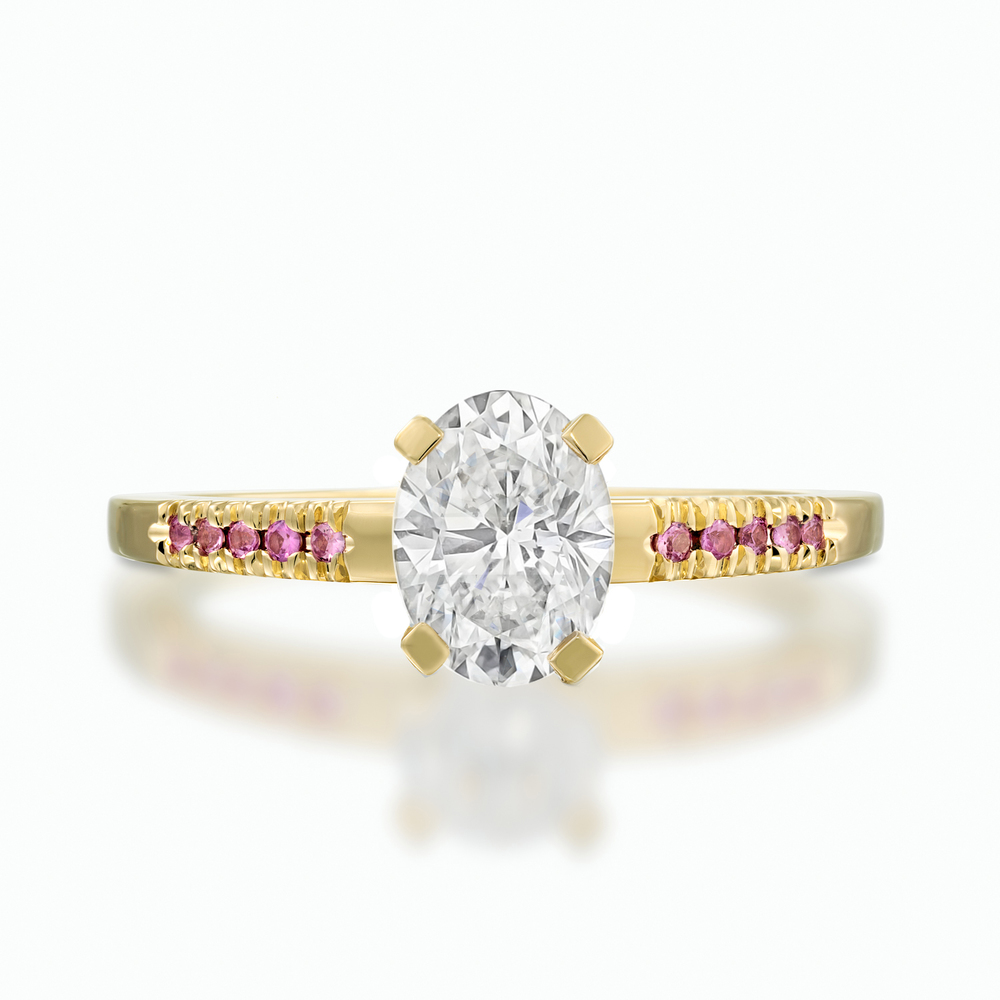 Elegant and minimalistic, this solitaire ring is composed of a beautiful white diamond and 14k yellow gold with a silky matt finish.   D: 0.11 ct.