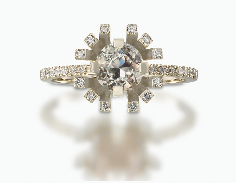 טבעת עם יהלום מרכזי בחיתוך אירופאי בגודל 0.75 קראט והילת יהלומים המקיפים אותו בחיתוך עגול