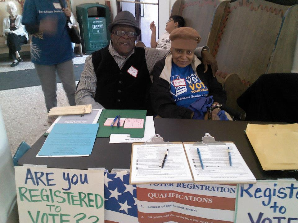 JASC leaders John and Audrey lead a voter registration table.