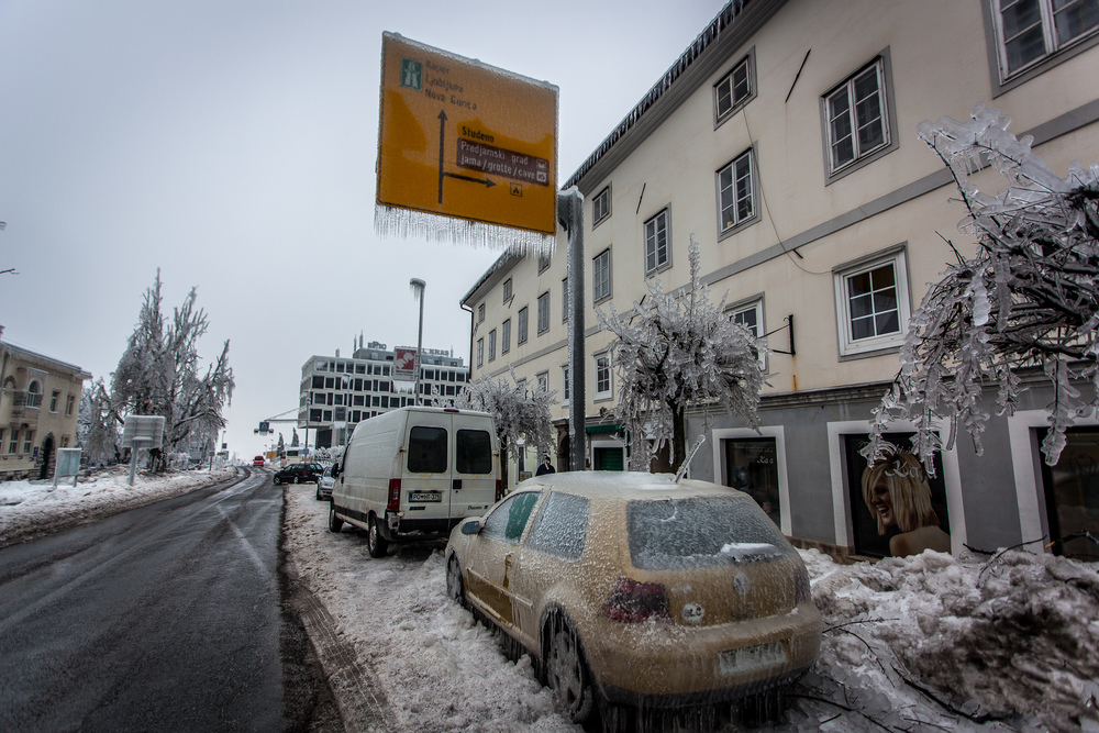 Picture taken along the main road in Postojna. Ice covers road signs, cars, mostly everything.