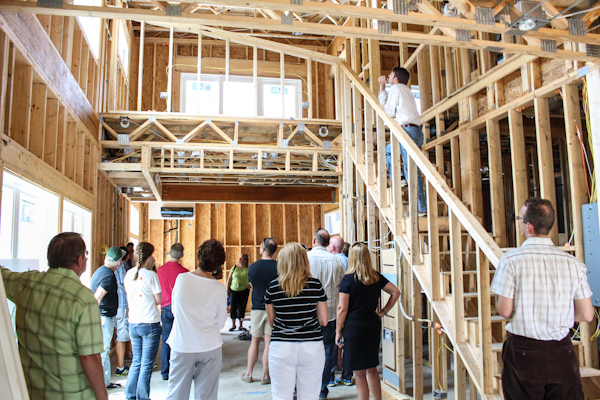 Members gathering inside one of the townhomes in progress at Tonbo Meadow