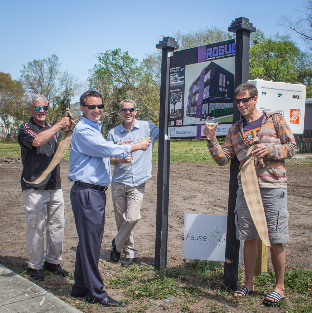 Architect Rob Romero, Realtor Randy Ruxta, and 'Upper 90 LLC' partners Bill Gilligan and Aaron Enright c heers after cutting the ribbon at the Rogue Townhomes jobsite - 802 North 4th St.  Wilmington, NC
