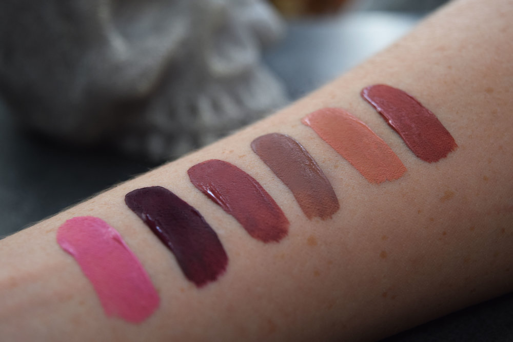 Swatches from left to right.; Melancholia, Exorcism,  Lolita , Bow N Arrow, Noble, Lolita ll
