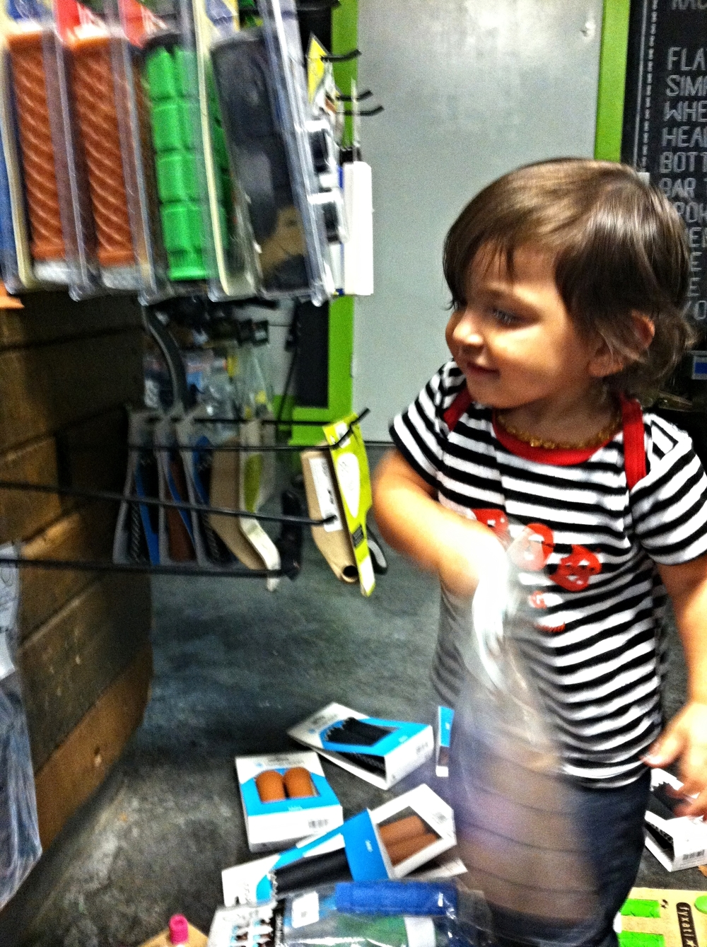 Just another day of hanging out and tearing down the bike shop with Richie's daughter, Ava.