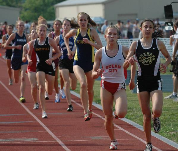 Danielle Tauro (Southern Regional) leading the 1600m in the bell lap, with Renee Tomlin (Ocean City) close on her heels. Jenn Ennis (Roxbury) in third, and I am coming up on the outside in the Hopewell uniform. Photo Credit nj.com.