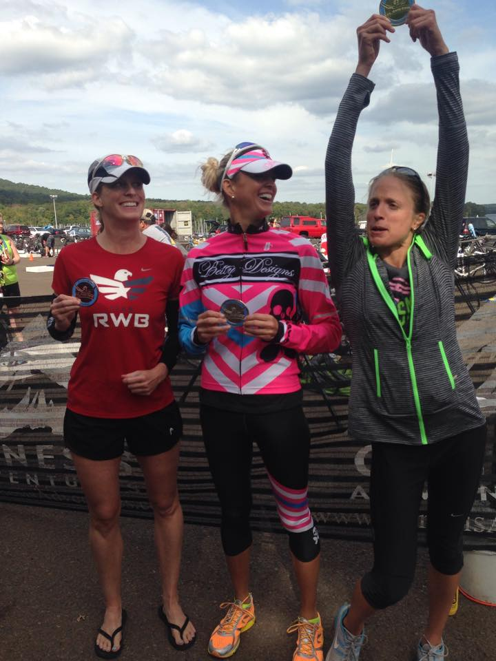 Top Three Female Finishers at the Olympic Plus Distance. No idea what I am doing, and clearly Katherine and Ginny don't either. Photo credit goes to Katherine's sister Jacky.