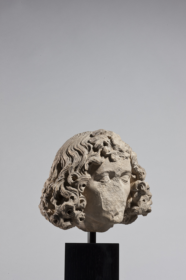 Michel Erhart (fl. 1469-1522) or his immediate circle Head of a sleeping male saint, perhaps John the Evangelist Germany, Ulm c. 1470-1480 24 cm high; sandstone