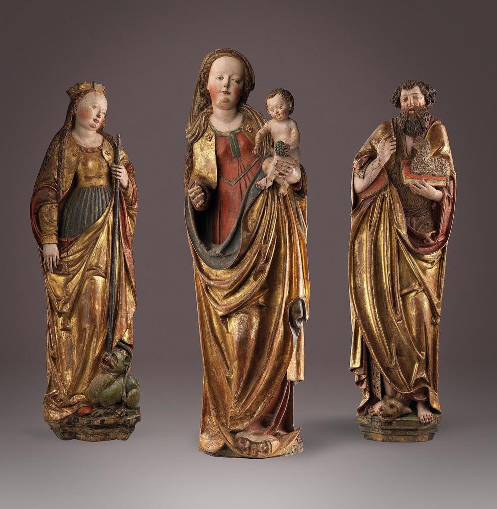 1125, 1126, 1127 Three Relief Carvings of the Virgin and Child, Saint Margaret and Saint John the Baptist Bamberg, Upper Franconia c. 1510 Height 126 cm, 132 cm, 128cm, limewood with original polychromy Provenance: Kathrein Collection, Southern Germany