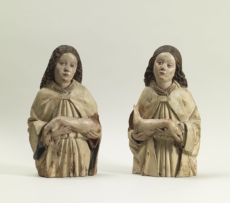 Two Mourning Angels Circle of Hans Multscher (c. 1400-1467) Southern Tyrol c. 1470 Height 40 cm (both), Swiss pine with original polychromy Provenance: Figdor Collection, Vienna