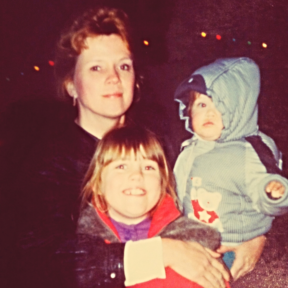 "My mom with my brother and myself in December 1991. On her Facebook page, my mom captioned this photo: ""This is what happiness looks like."""