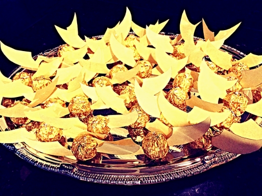 Crediting the ever awesome Pinterest, I made this adorable platter of snitches out of Ferrero Rocher chocolates and used gold scrapbook paper to cut out fluttery little wings, which I then hot glued to the candy. They were almost too pretty to eat, but I am pregnant, so that didn't stop me for long!