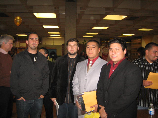 "David Lopez [2007, second from right]   Brian ""Bubba"" Kapko Football Scholarship  EHS Varsity Football Team Awards    Dion Domurat [2006, far right]   Brian ""Bubba"" Kapko Football Scholarship  EHS Varsity Football Team Awards"