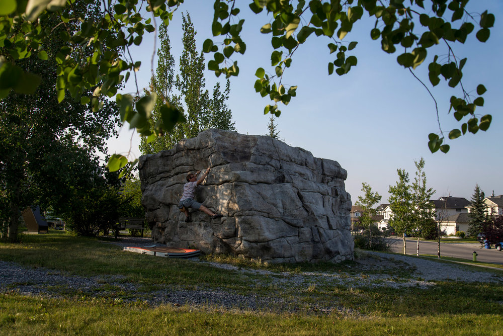 "A climber exercises on an erratic block in a residential area in Calgary, Alberta. This glacial erratic is found along what is known as the ""Foothills Erratics Train"", a 20km-wide corridor that stretches from Jasper to northern Montana, and is a proof of the glacier movement in western Canada during the last Ice Age, some 12,000 years ago."