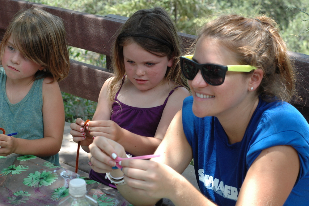 Campers might choose to weave a bracelet,