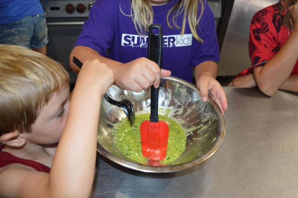 cooking in our kitchen, using fresh ingredients