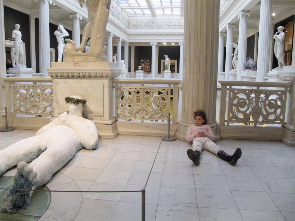 Nicole Eisenman sculpture and daughter George at the 2013 Carnegie International.