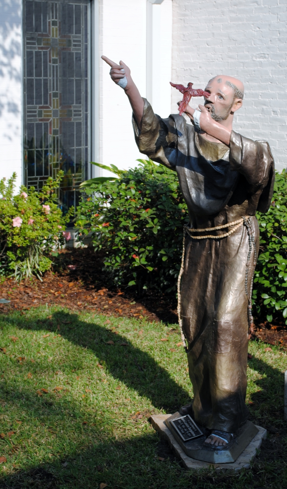 """""""St. Francis and the Cardinal"""":  Acrylic on resin sculpture set in a church garden area. (60"""" X 30"""")"""