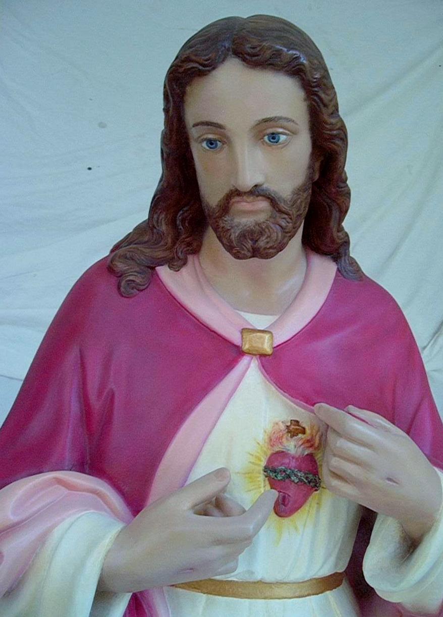 "Detail of restored cast plaster ""Sacred Heart of Jesus"" statue.  (64 X 30"")"