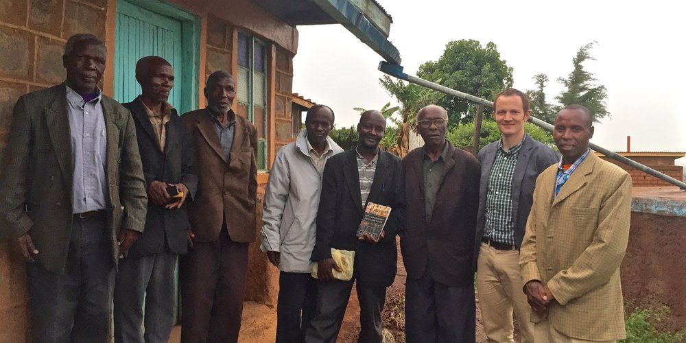 Visiting Pastor Paul (far right) in 2015.