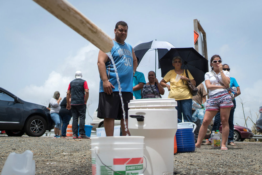 People have taken PVC pipes and line up wherever a makeshift spout has been created to collect water for their daily needs. Image from  NPR .