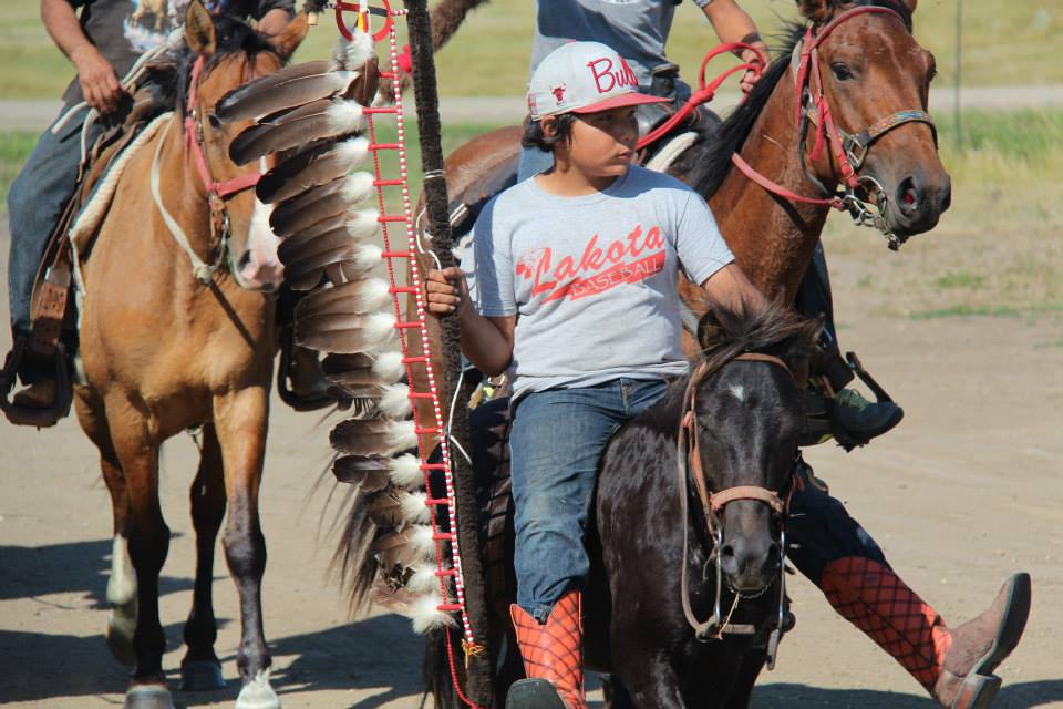Youth participate in ceremonial rides to honor elders and their community