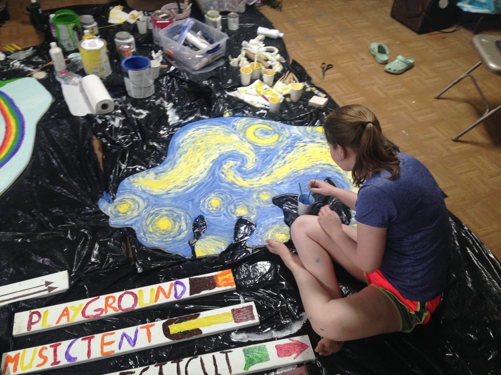 "Inner artist: Mary from the Silver Lake group expertly paints a ""Starry Night""-inspired buffalo to add to our whimsical herd that dots the prairie around the Community Center in La Plant. (A.Gross, La Plant, August 2015)"