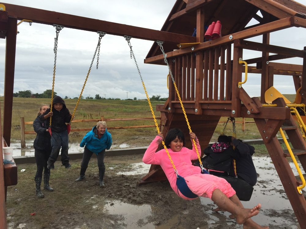 Muddy day fun on the new playground! Nothing deterred the kids from having fun after quite the rainstorm on Tuesday! (Z.Gross, La Plant, August 2015)