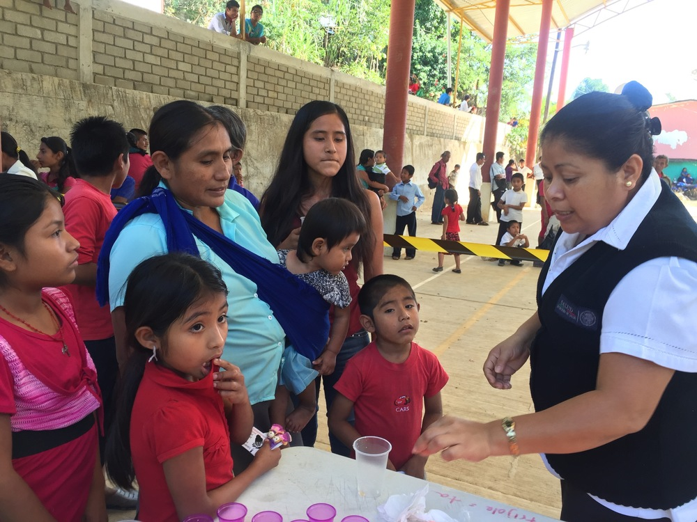 Nurse Bernarda Lopez Ordaz helps us to distribute treatment to children in Santa Maria Tepexipana (November 2015)
