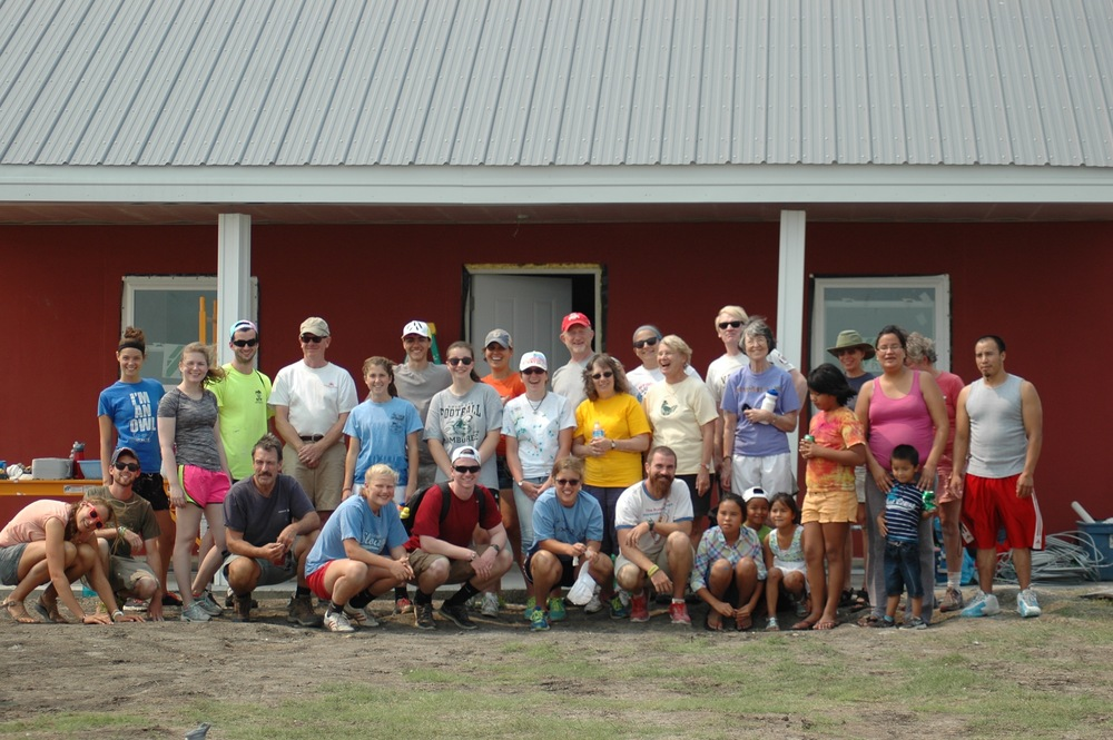 Gratitude in action: Our donors, volunteers, and many members of the Simply Smiles community make it possible for us to answer the call for safe, new homes. You've provide - and continue to provide! - the physical and metaphorical foundations for housing projects on the Reservation. Thank you! (La Plant, South Dakota, August 2015)