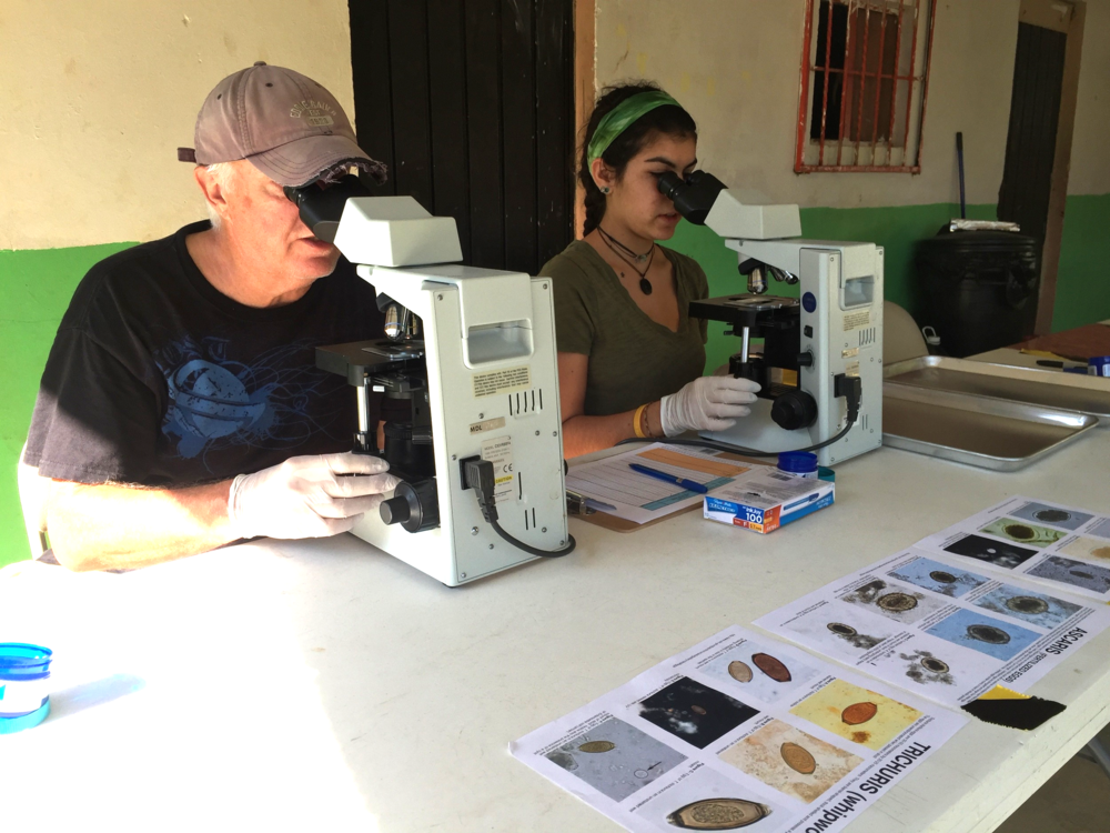 Erin, right, works alongside Simply Smiles board member and epidemiologist Dr. Gil L'italien to test stool samples for the presence of parasitic intestinal worms in Santa Maria Tepexipana and its neighboring communities.