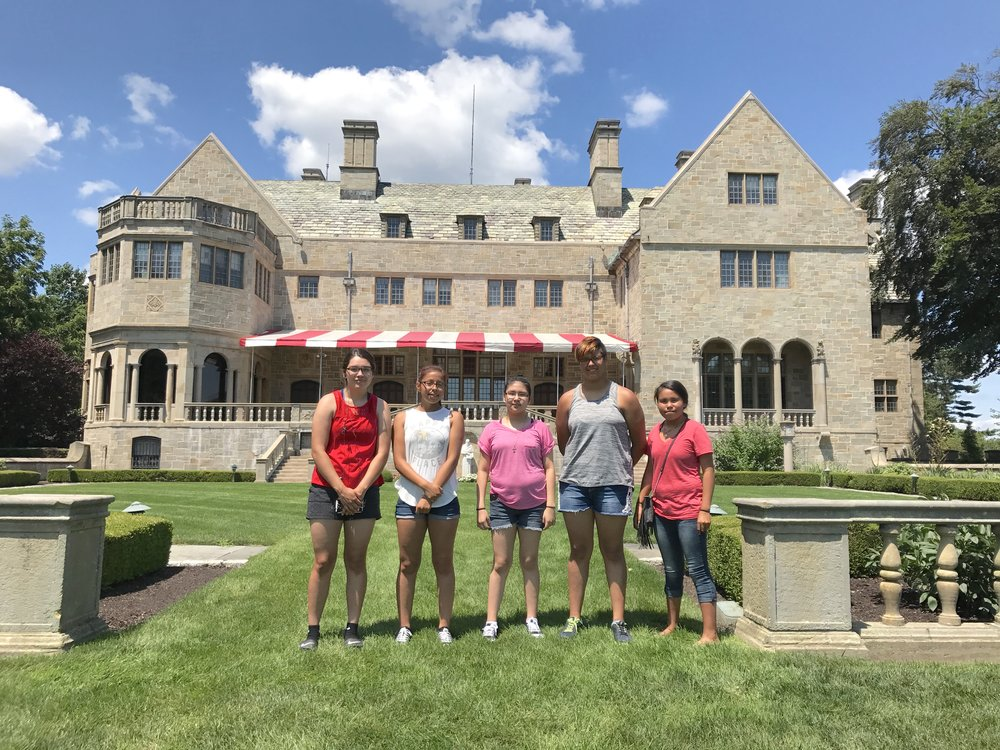 The girls stand in Bellarmine Lawn, where graduation ceremonies take place. In its partnership with Fairfield University, Simply Smiles is able to offer scholarships to students on the Reservation to attend the Connecticut university.