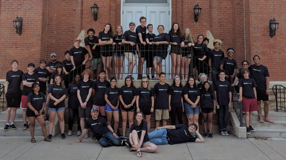 Members of the Plymouth Youth Group at Plymouth Congregational Church in Lawrence, KS, show off their Simply Smiles t-shirts upon returning from their 2018 service trip to the Cheyenne River Reservation in South Dakota.