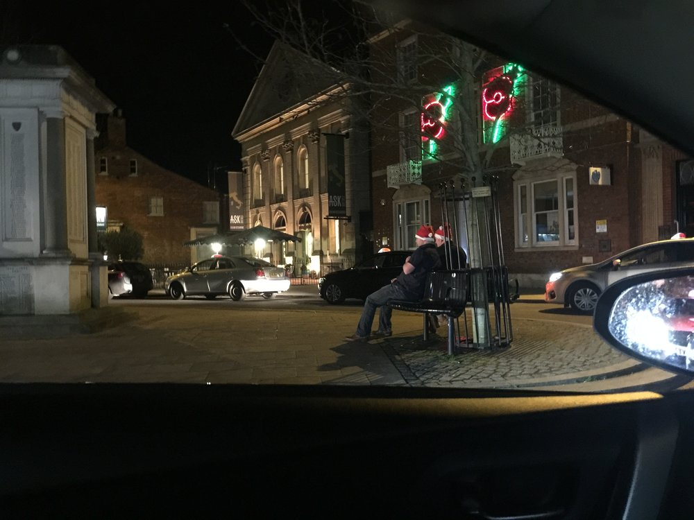 Taxis queue at night on The Square, Abingdon to get on an over subscribed taxi rank
