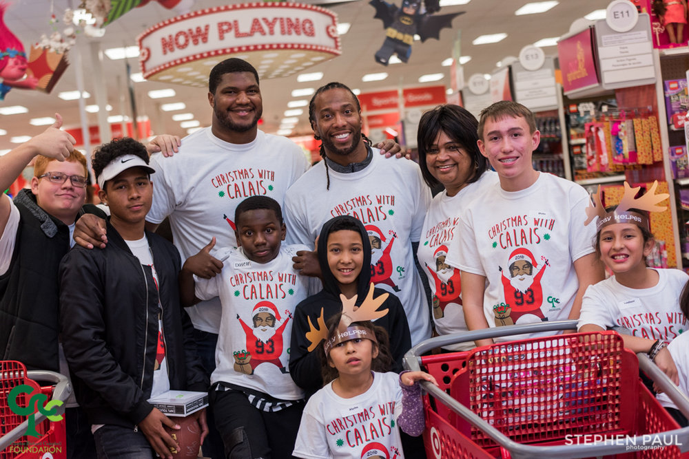 Arizona Cardinals stars Calais Campbell and Larry Fitzgerald take some children shopping.