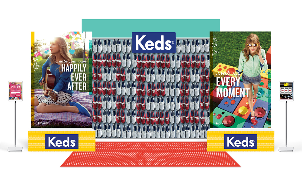 This was the booth I designed for Keds for use during Taylor's international RED Tour. In addition to signage, I created the look and feel of the app featured on the tablet display stands. Users would fill out their basic information, then would be led to a page where they could indicate their favorite shoes of Keds' selected inventory. Once selected, they would be brought to a digital slot machine on which they would try to match images in order to win various prizes. The Keds attendants would be notified when there was a winner, and they would distribute prizes accordingly.