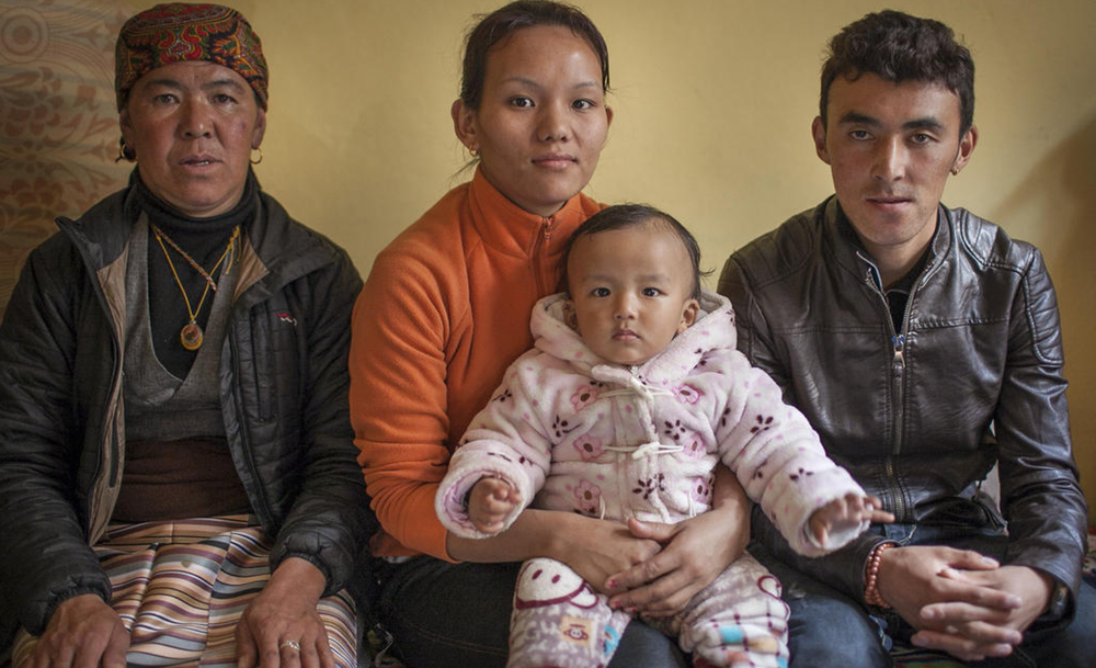 Ang Pasi, center, wife of Tenzing Chottar with her son Tshering. Her mother-in-law Lhakpa Chamjee and brother-in-law sit with her. This family is one of the beneficiaries of The Juniper Fund. (Rajneesh Bhandari/LA Times)