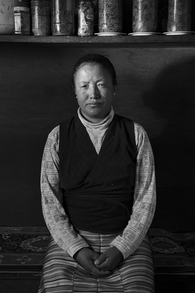 Lhamu Chhiki sits in the home she shared with her husband Chhewang Nima, who died on a 7000 meter peak expedition in 2010 when a cornice collapsed.  Photo: Grayson Schaffer