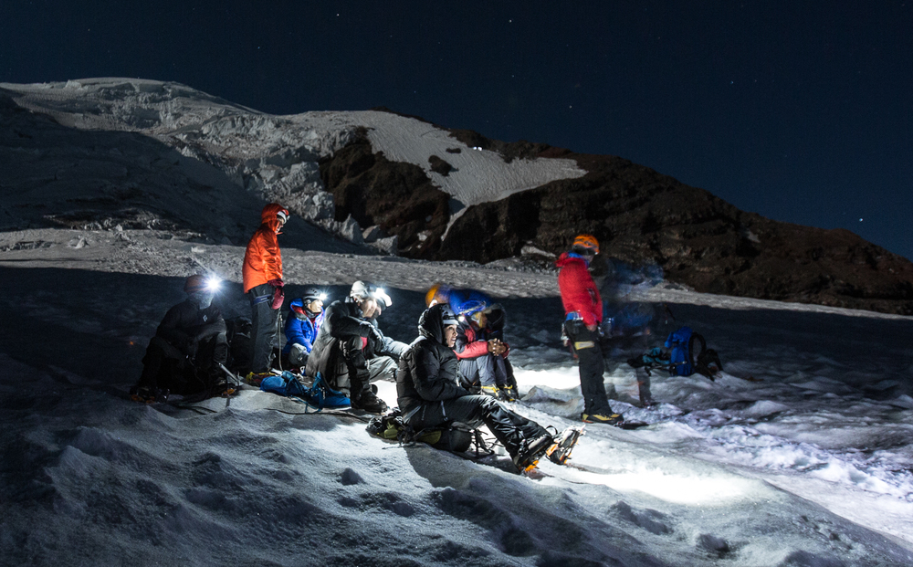 Rest break at Ingraham Flats, with headlamps above on Disappointment Cleaver behind us.  Photo by: Luke Humphrey