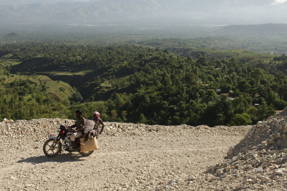 MCC's response to the 2010 earthquake included building a road connecting Biquette, a remote mountainous village to Desarmes. The road has enabled people to access medical help more quickly as well as now use vehicles to bring their crops to market.