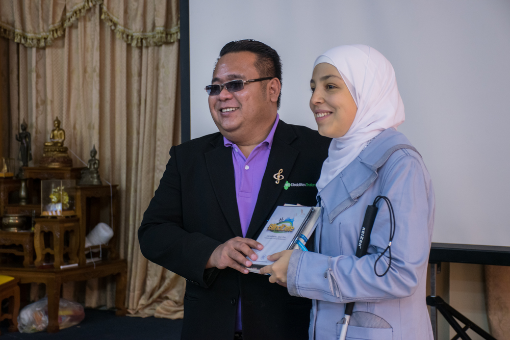 Mr. Torpong Selanon, the President of Thailand Association of the Blind, presenting gifts to Sara.