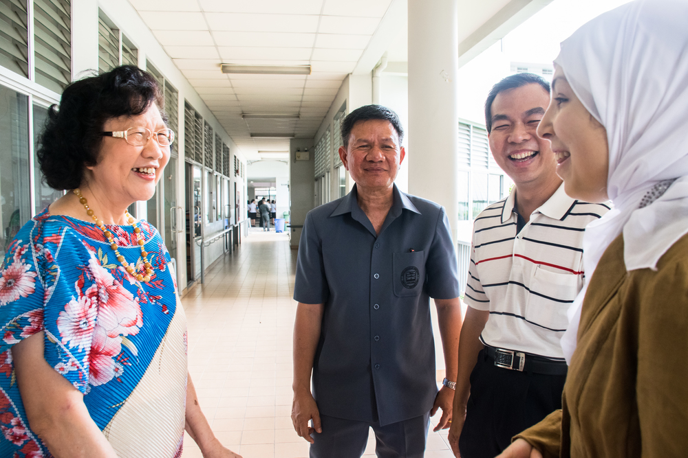 Sara and Hartanto having a conversation with the officials of The Bangkok School for the Blind