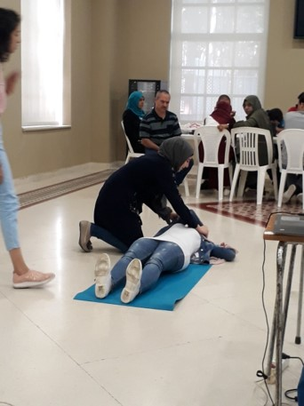Volunteers training on how to perform first aid in case of emergencies