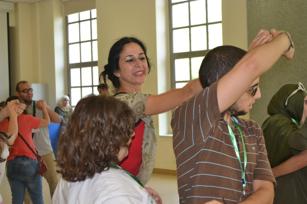 Visually impaired participants practicing dance moves with dance instructor